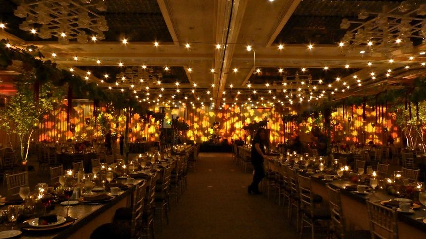 We helped convert this hotel ballroom into an autumnal country showplace, with a 100' wide tableau...