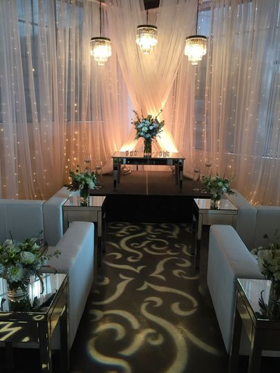 Elegant setting with projected patterns on the aisle, our fabulous cylinder chandeliers, mini string...