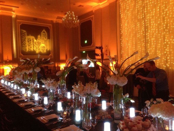 A fabulous long, family-style table, nestled into a sumptuous scene that included amber uplighting,...