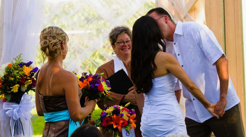 Rev. Gwen - a recent wedding.  Lovely couple with a daughter participating in the ceremony and vows.