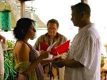 Rev. Zenobia performing a destination wedding ceremony.
