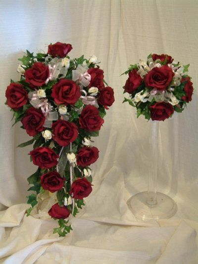 Made to Coordinate with Your Color Scheme. http://www.weddingbouquets.com/html/burg_roses.html