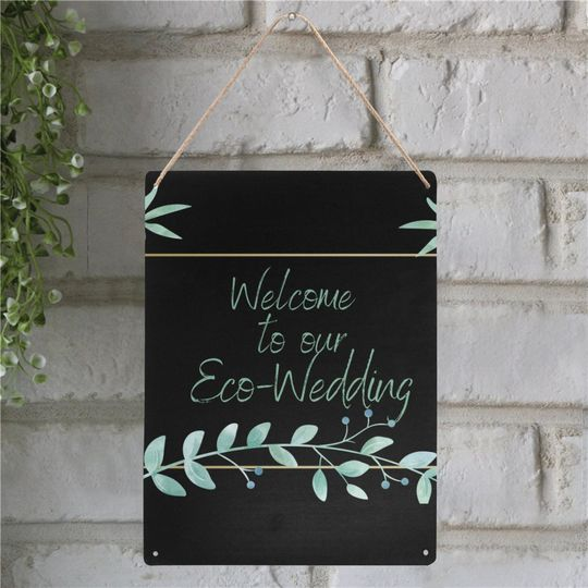 Welcome metal sign on brick