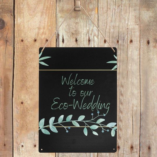 Welcome metal sign on wood