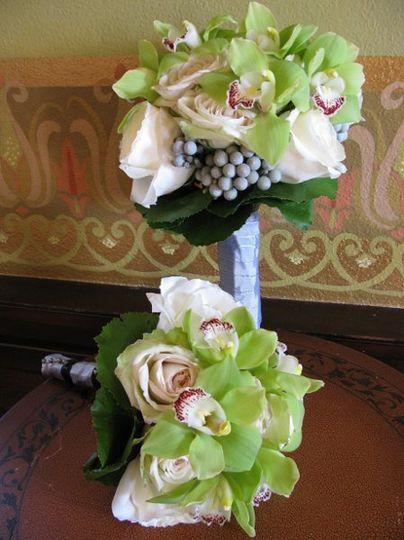 "Cymbidium Orchids, ""Vendella"" Roses, Brunnea, Galax foliage"