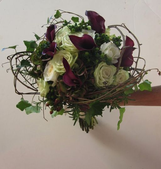 For the outdoorsy natural bride, grape vine was wrapped around the calla lilies, green and ivory...