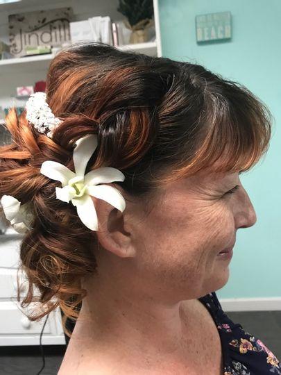 curly beach bridal flower updo