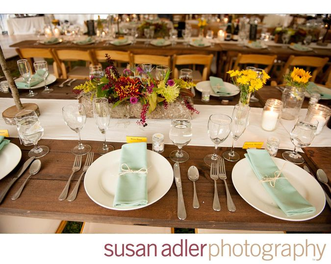 Gorgeous tablescape, rustic farm tables, hollowed birch logs for the flowers and candles everywhere!