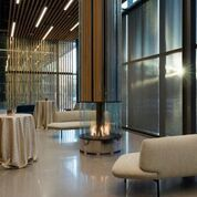 The Lounge is a quiet space that offers a fireplace and floor to ceiling windows.