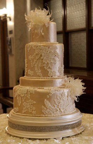 Beige wedding cake with white patterns