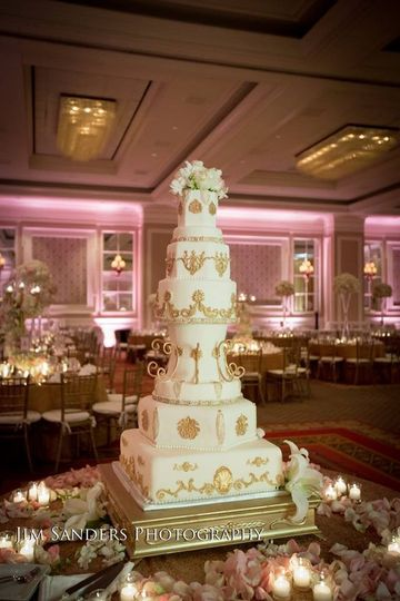 Uniquely shaped tall wedding cake