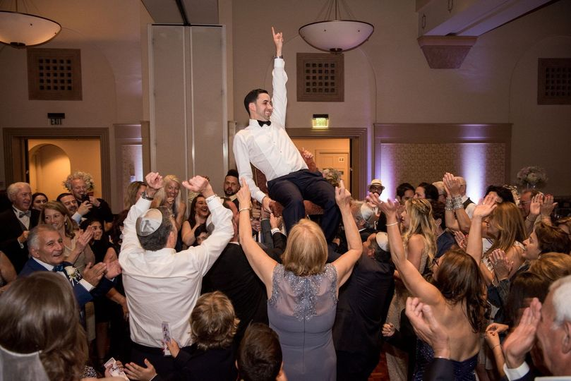 Groom carried by the crowd