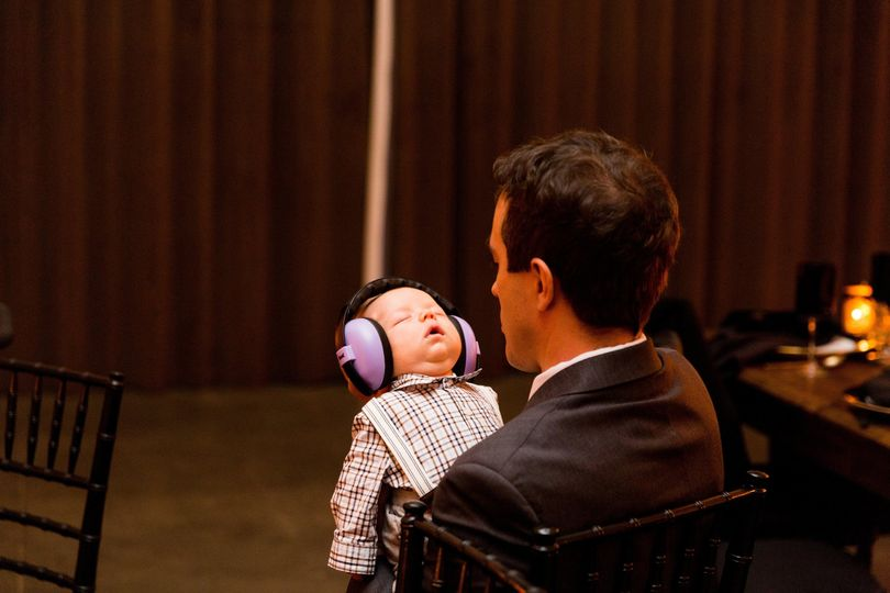 Baby with ear muffs