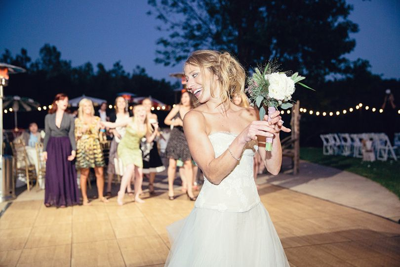 Bride tossing the bouquet