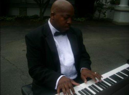 Ken playing the keyboard
