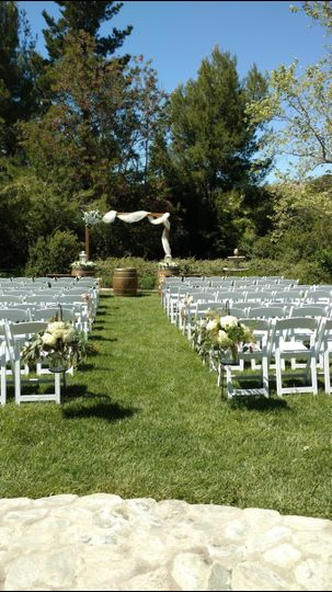 Personal touches with homemade arch, custom flowers & decor