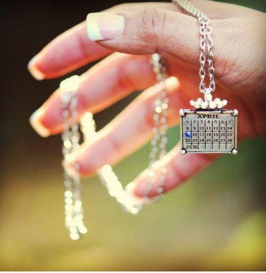 Crown calendar necklace