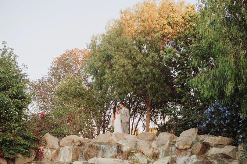 Couple standing on waterfall