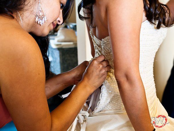Final touches on the wedding dress