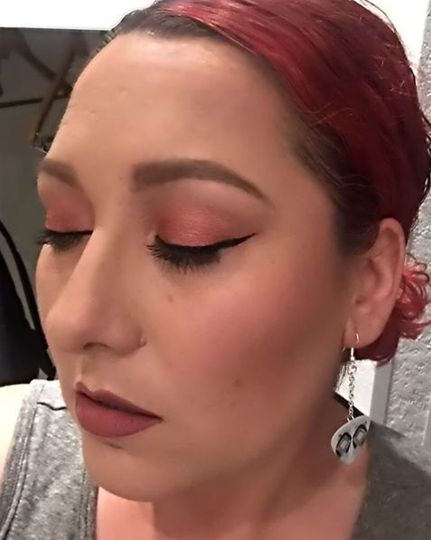 Light red eyeshadow to match bride's red hair
