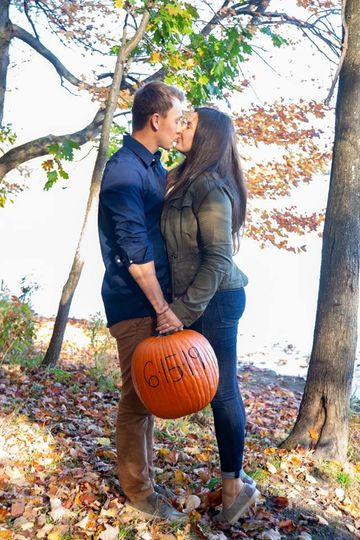 Fall engagement with pumpkin