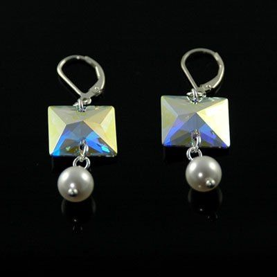 Swarovski™ sparkling button earrings enhanced with 8mm pearls. Wear these alone or with our other...