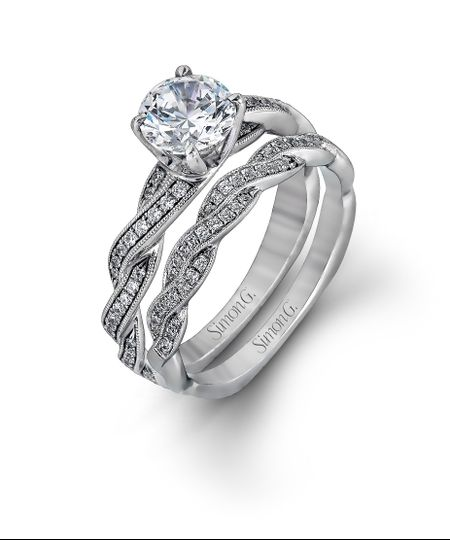 Style MR1498  This exquisite white contemporary engagement ring features a delicate twist design...