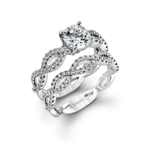 Style MR1596  The intricate twisted design of this modern white gold engagement ring and wedding...