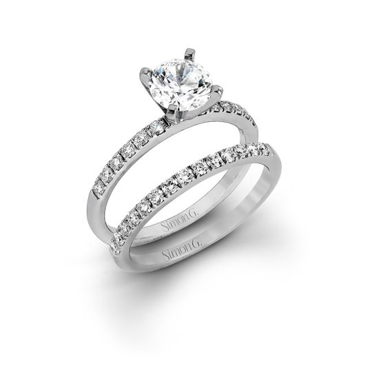 Style MR1686  Featuring a modern take on a classic design, this white gold engagement ring and...