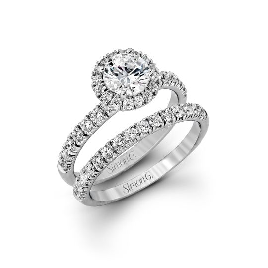 Style MR1811  The classic halo design of this white gold engagement ring and wedding band are...