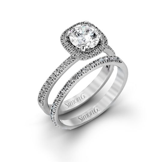 Style MR1842-A  Accented by .46 ctw of glistening round cut white diamonds, this contemporary...