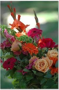 Bright Floral Arch piece with pink and orange roses, gladiolas and gerbera daisies. $125
