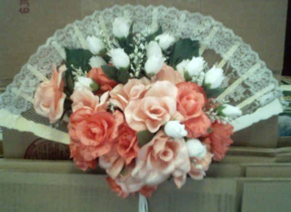 This unique bouquet is the perfect accent to your bridal party dresses.  Each bouquet is custom made...