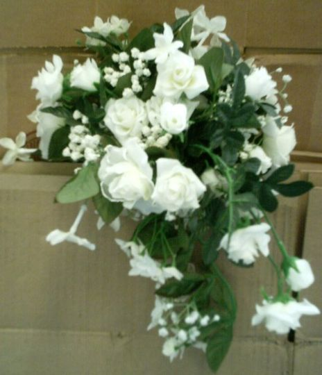 This unique small bouquet will be the perfect accent to your wedding dress.  Our use it as the extra...