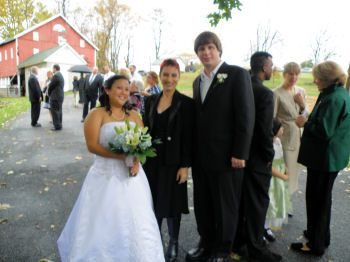 Newlyweds and officiant