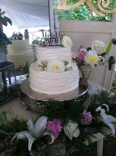 Textured two tier cake with white flowers