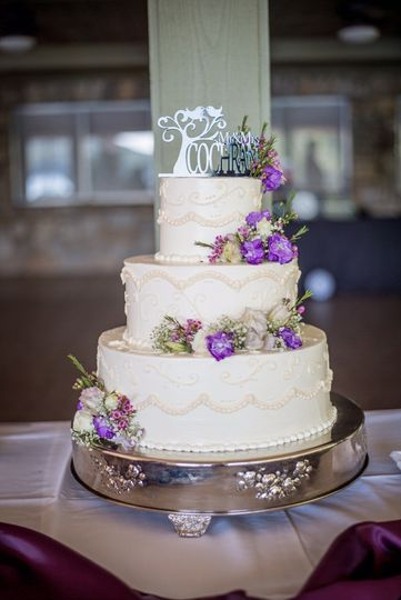 Purple flowers decorating wedding cake