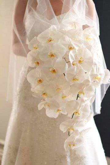 Bride with white wedding flowers