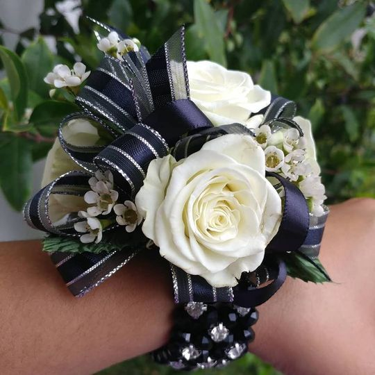 Corsage with black ribbon