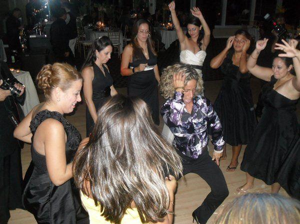 Dancing bride and guests