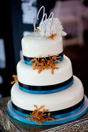 White cake with blue ribbon bands