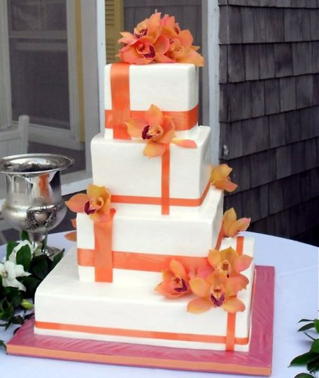 Square cake with orange decorations