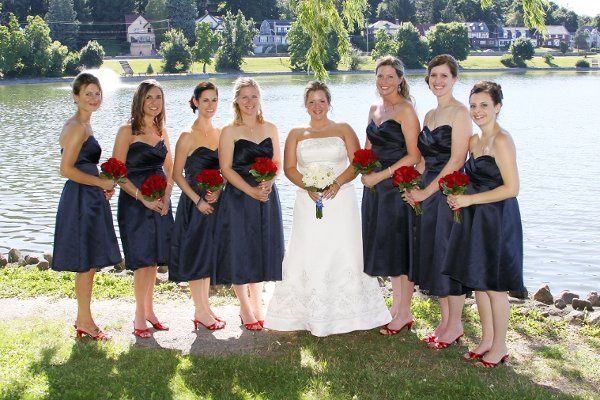 Bride and bridesmaids by the water