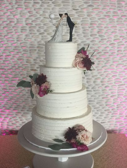 4-tier cake with bride and groom figurines