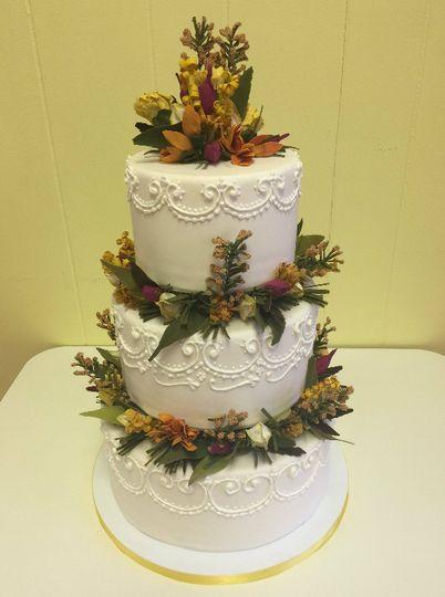 3-tier wedding cake with flowers