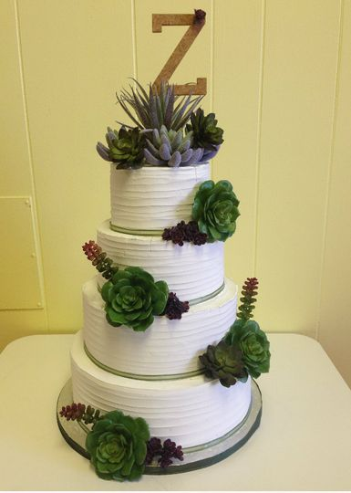 4-tier wedding cake with initial