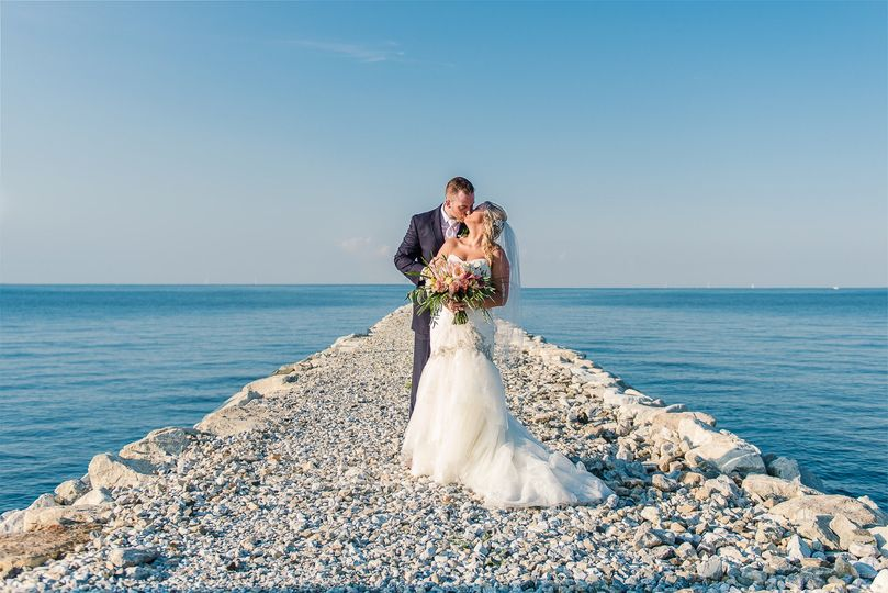 emily annette photography northern virginia nova wedding photographer herrington on the bay yacht club wedding chesapeake bay bride groom beach portrait symmetrical creative shot 51 999631