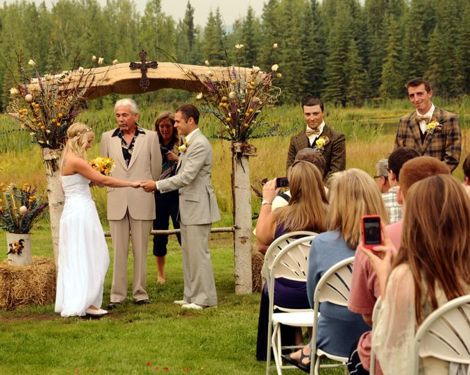 Rustic wedding arch provided