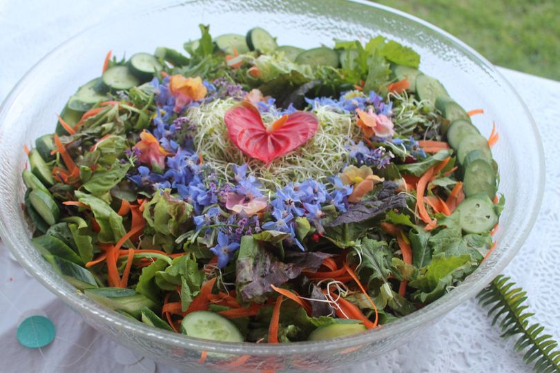 Signature salad design with accompanied dressings of lilikoi and papaya