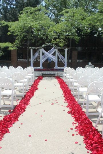Wedding ceremony set up aisle runner and flowers